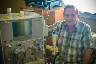 Antle sits next to dialysis pump