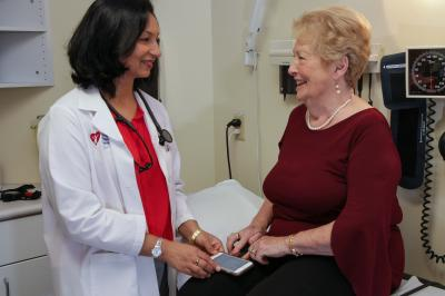 Patients like Joyce Cormier, with Dr. Parkash (r) taking part in the atrial fibrillation virtual clinic receive devices to track physical activity, heart rate and rhythm, so researchers can see how activity impacts their heart health during the study