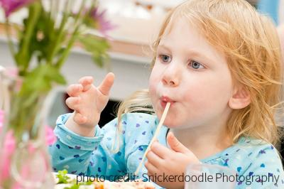 Girl enjoys snack at Dartmouth North Community Food Centre