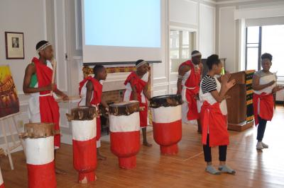 Janvier Nahimana leading a group of Burundian drummers and dancers