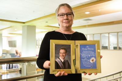 NSHA patient safety leader Denice Klavano holds a photograph of her late son, Brad Howell, who chose to be an organ and tissue donor just months before his tragic accidental death (Lesley Anne Squarey/NSHA).