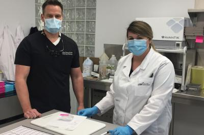 Medical laboratory technologist Alison Jones, with dermatologist and Mohs surgeon, Dr. Michael Stevens in the onsite lab.