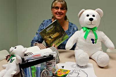 Organ donor coordinator Rhonda Porter surrounded by items for comfort and care kits given to grieving families (Kristen Lipscombe/NSHA).