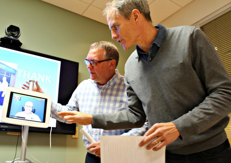 Halifax Infirmary emergency department health services manager Robert MacKinley and chief Dr. Samuel Campbell chat with a virtual Arabic translator during a classroom session held recently for local refugees in conjunction with the Immigration Services As