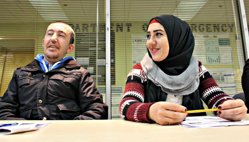 Mohammad Hasan, 30, and Ebitsam Hasan, 27, siblings who came to Canada from Syria in January, learn about how to use the Halifax Infirmary's various services, including a new virtual translation service and the emergency department.